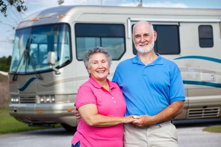 Older couple outside RV